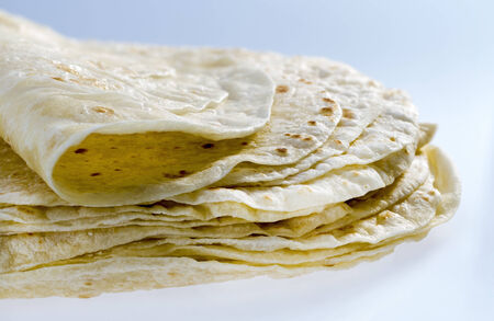 Pile of flour tortillas, closeup shoot . Stock Photo