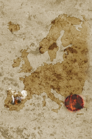 Grungy map of europe with greece burning and spain smoking