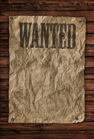 Wanted sign on wooden wall photo