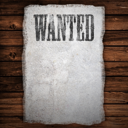 Wanted sign on wooden wall