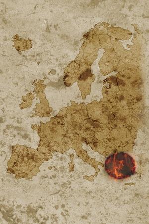 burning money: Grungy map of europe with greece burning