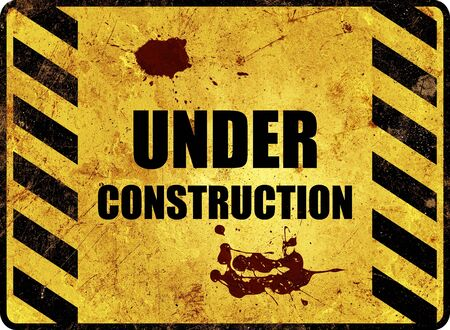 An rusty under construction warning sign in yellow and black photo
