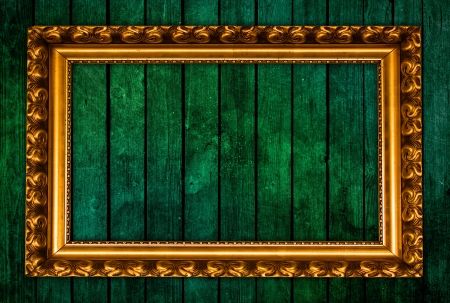 golden frame on green grunge wall photo