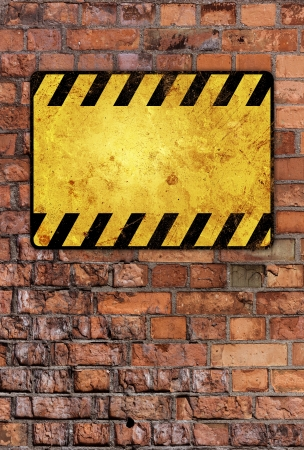 a brick wall with a warning sign Stock Photo - 19782883