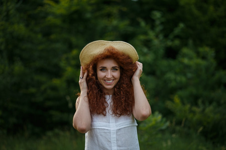 straw the hat: Girl in a straw hat