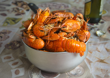 many red cooked appetizing crayfish in the scoop on the table Imagens