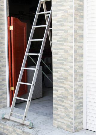 Iron a ladder of a step grey silvery building repair Reklamní fotografie