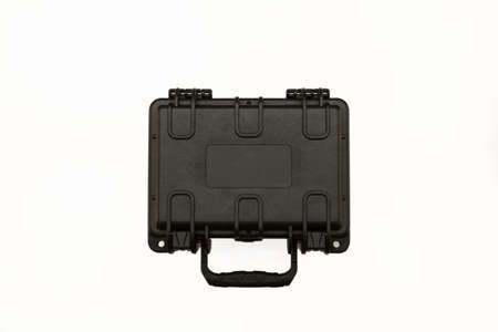 Open black plastic case with foam inside. Black plastic hard case for transporting and storing weapons. on a white background.