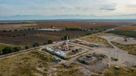 pulling equipment in oil field between mountain