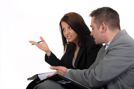 Businessman and Buinesswoman in Discussion