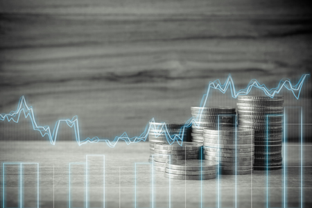 double exposure of rows of coins and Business graph in finance and banking concept Stock Photo