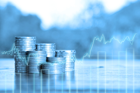 double exposure of rows of coins and Business graph in finance and banking concept 免版税图像
