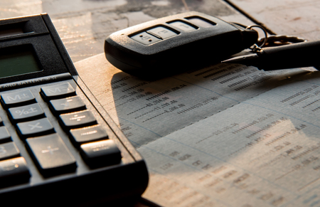 total loss: close up of calculator ,car remote and account book in finance and banking concept