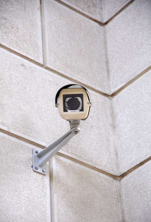 Security camera in a cone on a wall Stock Photo - 13307389