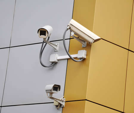 Tree CCTV security cameras on a wall Stock Photo - 13307381