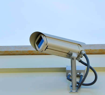 Security cam on a wall Stock Photo - 13307378