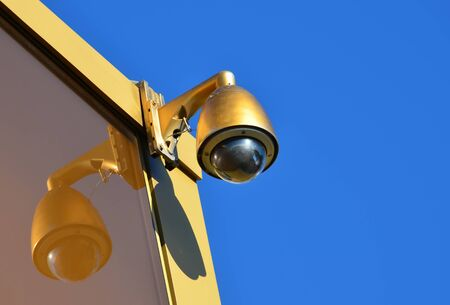 Golden Hi-tech dome type camera and a blue sky Stock Photo - 17349790