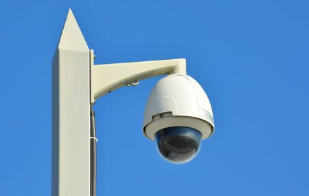Dome type CCTV camera on the blue sky Stock Photo - 17349752