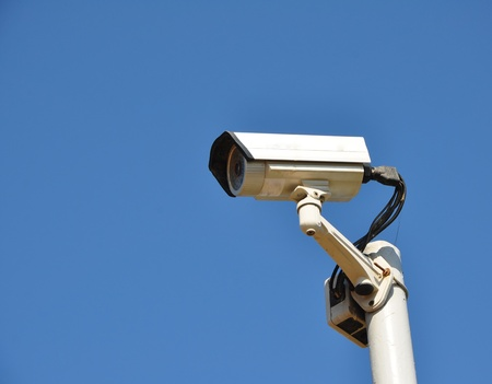 dome type: IR surveillance camera against blue sky Stock Photo