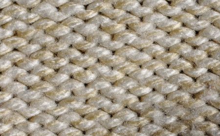 cable stitch: Beige acrylic knitting, textile background