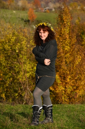Pretty young woman in autumn park photo