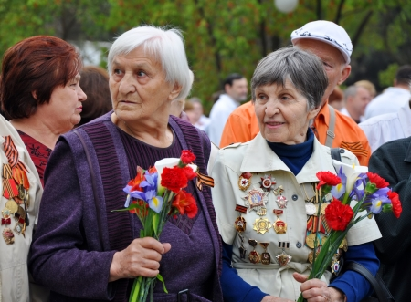 Women - World War II veterans with flowers in their hands celebrate Victory Day on May 9, 2012 in Sochi, Russia   Stock Photo - 17355568
