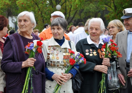 Women - World War II veterans with flowers in their hands celebrate Victory Day on May 9, 2010 in Sochi, Russia
