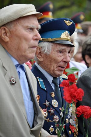 Unidentified veterans lay flowers at Victory Monument during the celebration of Victory Day on May 9, 2012 in Sochi, Russia