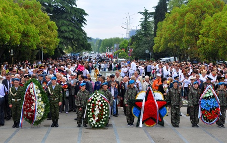 Unidentified veterans  and citizens lay flowers at Victory Monument during the celebration of Victory Day on May 9, 2012 in Sochi, Russia Stock Photo - 17355648