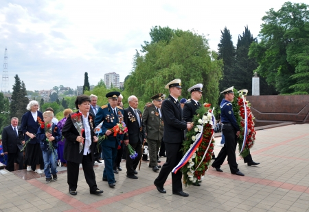 croud: Unidentified veterans lay flowers at Victory Monument during the celebration of Victory Day on May 9, 2012 in Sochi, Russia
