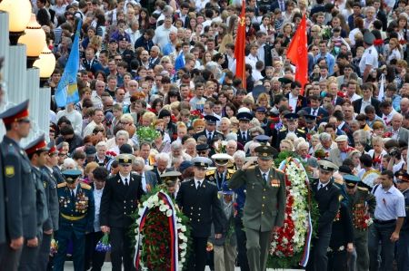 Crowd of citizens and  veterans lay flowers at Victory Monument during the celebration of Victory Day on May 9, 2010 in Sochi, Russia  Stock Photo - 17355640