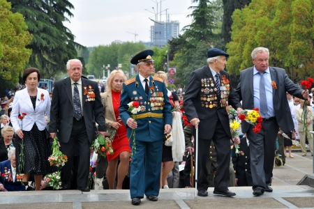 Citizens and veterans lay flowers at Victory Monument during the celebration of Victory Day on May 9, 2012 in Sochi, Russia Stock Photo - 17355632