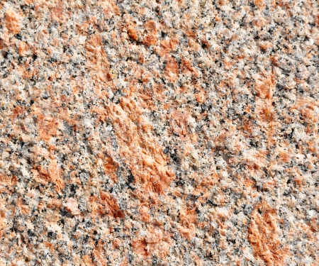Red granite texture close-up photo