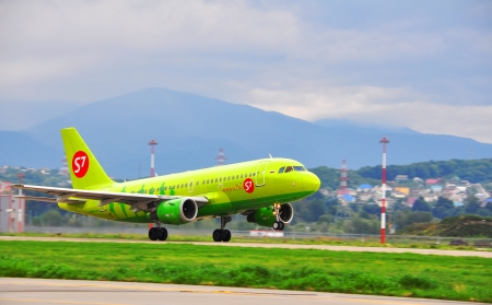 SOCHI,RUSSIA-AUGUST16   Airbus A-319,  passenger airliner of S7 airlines  Siberia on the rise on August 16, 2012 in Sochi, Russia  In May 2012 marks the 20th Anniversary of the airline  Siberia  Editorial