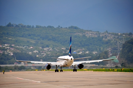 arctic zone: SOCHI,RUSSIA-AUGUST16   Boeing-757-200 of Yakutia airlines taxiing to disperse on August 16, 2012 in Sochi, Russia  In 2012  Yakutia  flies to 11 destinations within the program of subsidized transport residents of the Arctic zone of Yakutia  Editorial