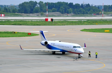Airplane of Ak-Bars avia  on the platform of the International Sochi airport on August 16, 2012 in Sochi, Russia  Company was founded in 1953 and now is a regional airline at the federal level in Russia
