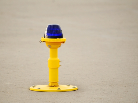 Ground side lamp taxiway at the airport Stock Photo