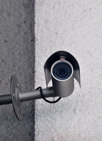 Black security camera in a cone on a stone wall  photo