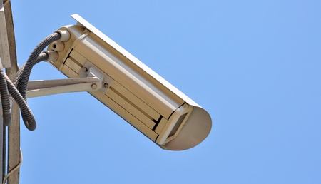 Surveillance cam on sky background watch right  Stock Photo - 17398600