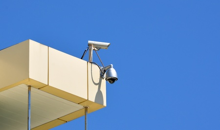 Surveillance cam and dome type camera on a top Stock Photo - 17398491