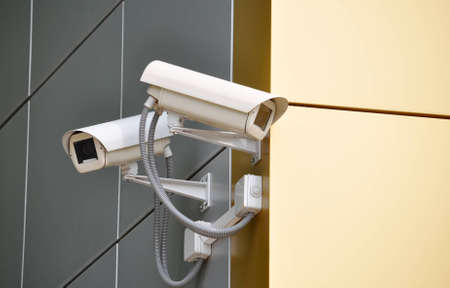 Two CCTV cameras on the cone of the morden building Stock Photo - 17398394