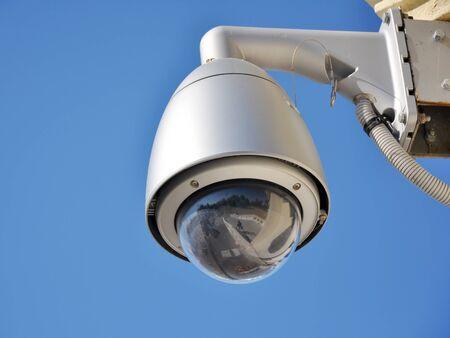Hi-tech dome type camera and a blue sky Stock Photo - 17400909