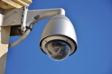 Dome type surveillance camera on a wall 