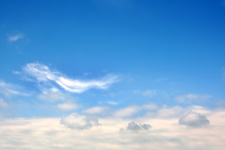 Beautiful fluffy white clouds on the blue sky Stock Photo - 17398428