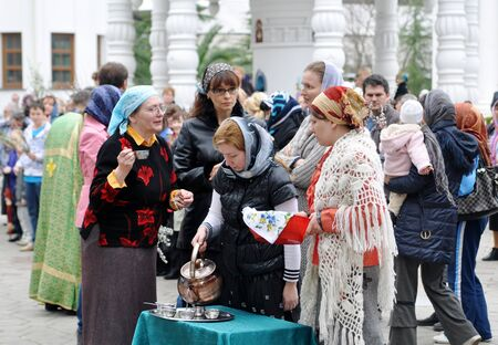 palm sunday: SOCHI, RUSSIA � APRIL 15  Parishioners of the Cathedral of Archangel Michael in Sochi celebrate Palm Sunday on May 15, 2012  Women drink the holy water Editorial