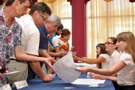 preliminary: SOCHI, RUSSIA - JULY 23  Voting in the preliminary elections  primaries  to the Legislative Assembly of Krasnodar Region of the fifth convocation on July 23, 2012 in Sochi, Russia  The voter receives a ballot