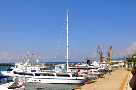 Motor and sailing yachts in the harbor, the sea port of Sochi Stock Photo - 17401460