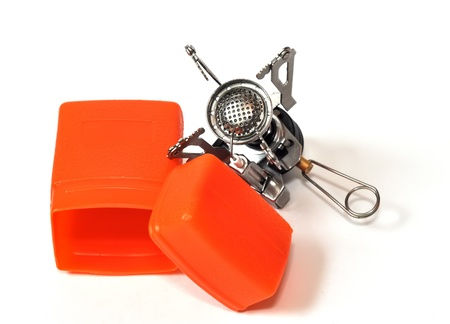 Camping gas stove whith orange plactic box isolated on white photo