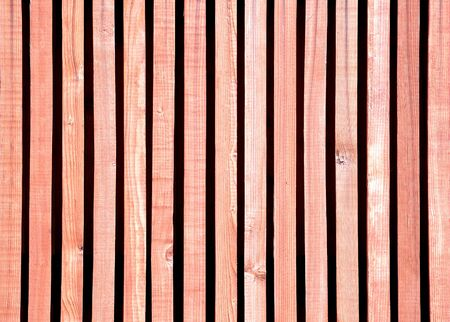 The wooden horizontal background of narrow strips with knots Stock Photo