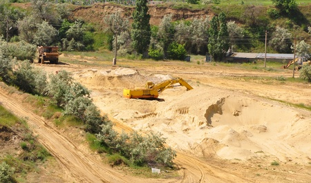 Excavators in the sand pit, the general view from above Stock Photo - 17435228